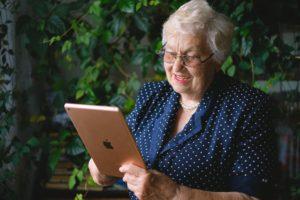 older lady on ipad